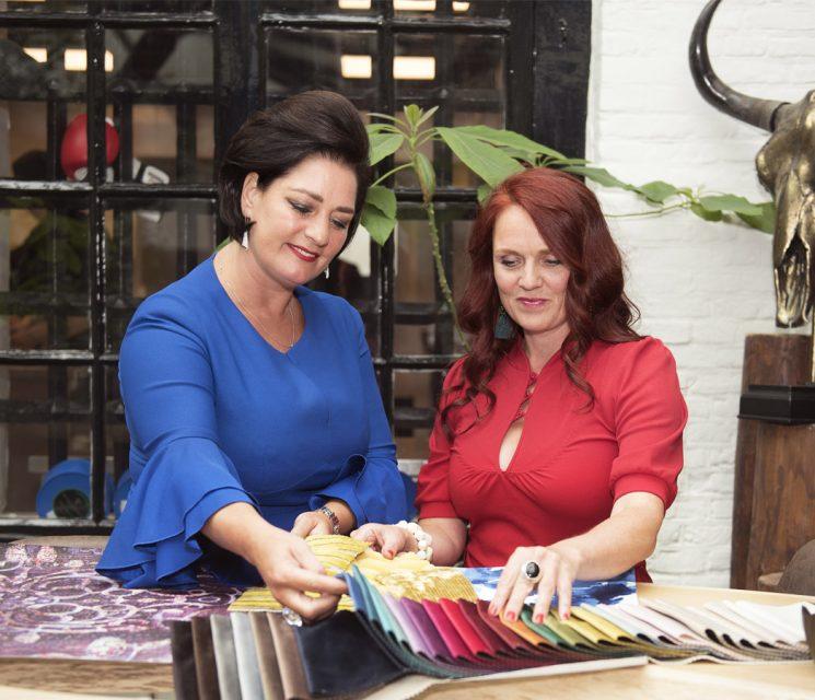 Ingrid of luxury interior designers Costa Blanca discussing colour options with client