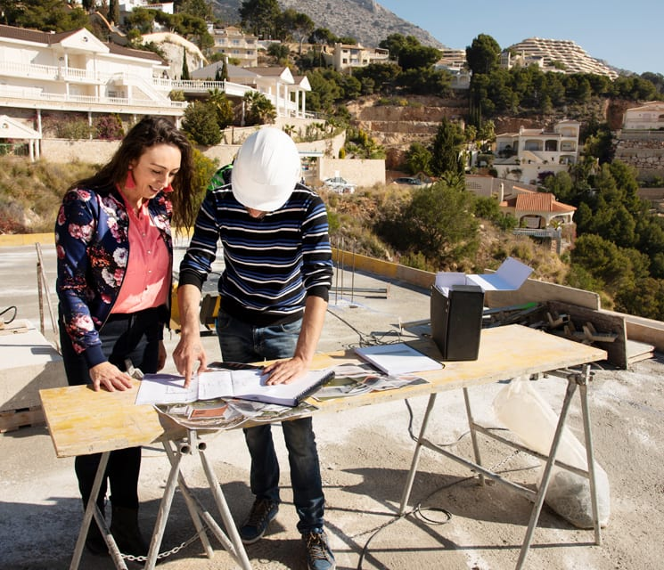Ghita and builder of luxury interior designers Costa Blanca discussing plans on construction site