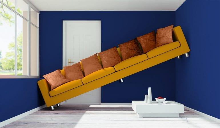 mustard coloured sofa in blue room for a villa or finca on the costa blanca