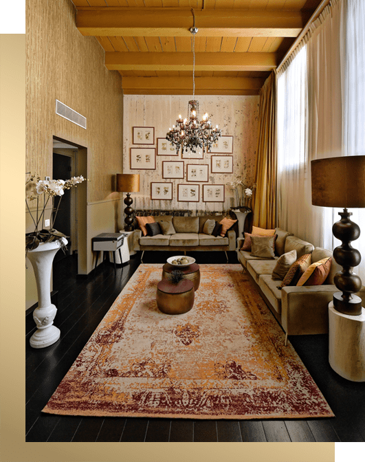 Green sofa in brown gold hotel room by Costa Blanca interior design studio