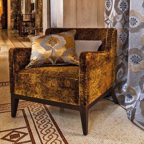 Mediterranean interior styling of ochre Camego arm chair ,