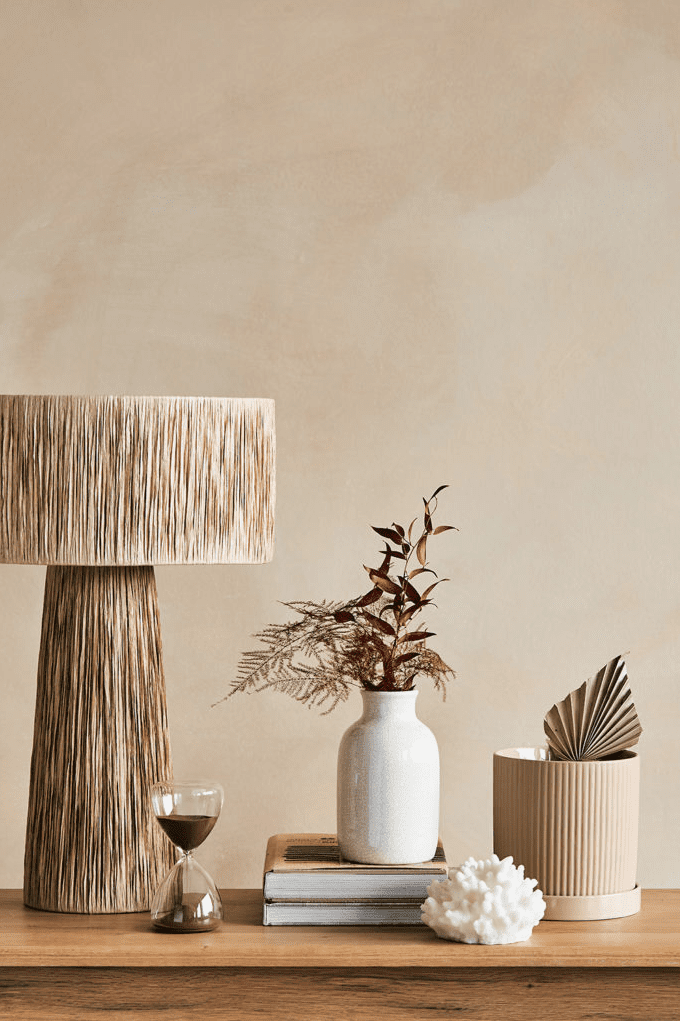 Table with nutral lamp and vases by Interior Designers Rose & grey
